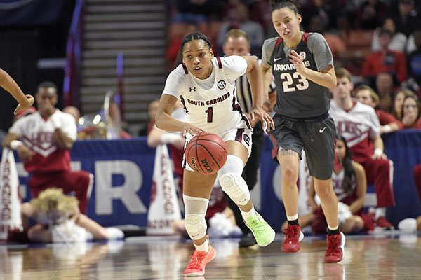 South Carolina's Zia Cooke (1) steals a ball away from Arkansas' Amber Ramirez (23) during the second half of a semifinal match at the Southeastern Conference women's NCAA college basketball tournament in Greenville, S.C., Saturday, March 7, 2020. (AP Photo/Richard Shiro)