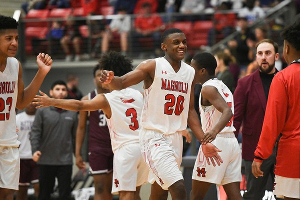 Magnolia guard Derrian Ford (20) reacts, Friday, March 6, 2020 during a basketball game at Cardinal Arena at Farmington High School in Farmington. Ford also lead the team on Saturday with 36 points in a 2 OT win over Brookland to advance to the Class 4A State Boys final for a second straight year. (NWA Democrat-Gazette/Charlie Kaijo)