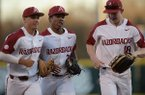 Arkansas center fielder Christian Franklin (center) is congratulated Tuesday, March 10, 2020, by right fielder Heston Kjerstad (right) and second baseman Robert Moore after Franklin threw out Grand Canyon designated hitter Dominic Grissom as Grissom attempted to advance from second to third on a ball hit to the outfield during the second inning at Baum-Walker Stadium in Fayetteville.