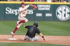 Arkansas' Casey Martin watches his throw to first base after catching Grand Canyon University's Brock Burton at second Wednesday March 11, 2020 at Baum-Walker Stadium in Fayetteville. Arkansas beat Grand Canyon 10-9 on Wednesday.