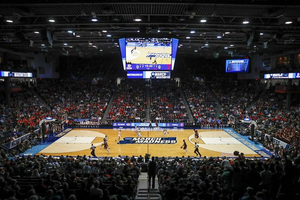 Spectators watch from the stands during the first half of a First Four game of the NCAA basketball tournament between Temple and Belmont on March 19, 2019, in Dayton, Ohio. NCAA President Mark Emmert says NCAA Division I basketball tournament games will be played without fans in the arenas because of concerns about the spread of coronavirus. - Photo by John Minchillo of The Associated Press