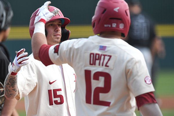 Arkansas shortstop Casey Martin (15) is greeted at home plate by catcher Casey Opitz (12) after Martin hit a home run during a game against Grand Canyon on Wednesday, March 11, 2020, in Fayetteville.
