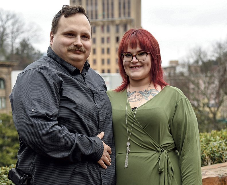 Blogger and recovering addict Emily Tilley, right, has her photo taken with her husband Mason on The Grand Promenade on February 23, 2020.-Photo by Grace Brown of The Sentinel-Record
