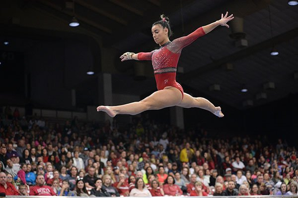 Arkansas' Sophia Carter competes Friday, Feb. 7, 2020, in the beam portion of the Razorbacks' meet with Georgia in Barnhill Arena in Fayetteville.