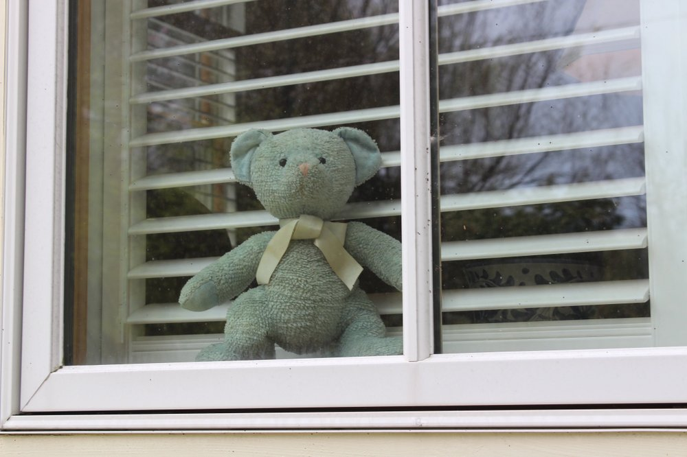 Why is that teddy bear in the window? So bored children can walk the neighborhood or ride with their parents to spot it on a Facebook inspired Bear Hunting. This one was photographed in downtown Little Rock.  (Arkansas Democrat-Gazette/Rachel O'Neal)