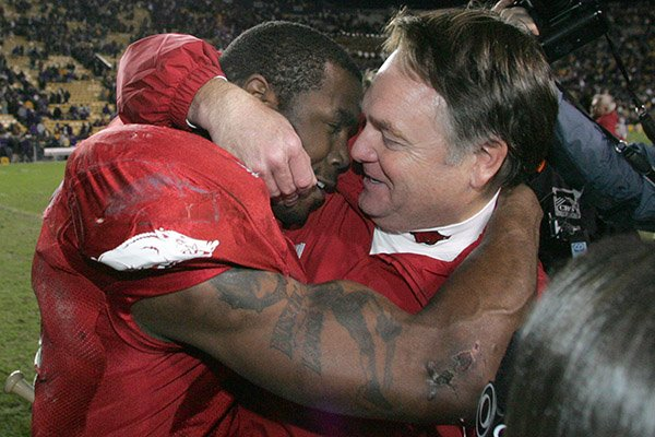 Arkansas coach Houston Nutt (right) hugs running back Darren McFadden following a 50-48 upset of No. 1 LSU on Friday, Nov. 23, 2007, in Baton Rouge, La.
