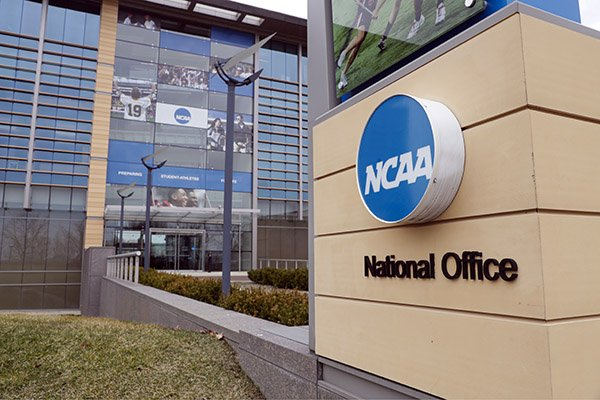 This March 12, 2020, file photo, shows the national office of the NCAA in Indianapolis. The NCAA will distribute $225 million to its Division I members in June, $375 million less than had been budgeted this year because the coronavirus outbreak forced the cancellation of the men's basketball tournament. (AP Photo/Michael Conroy)