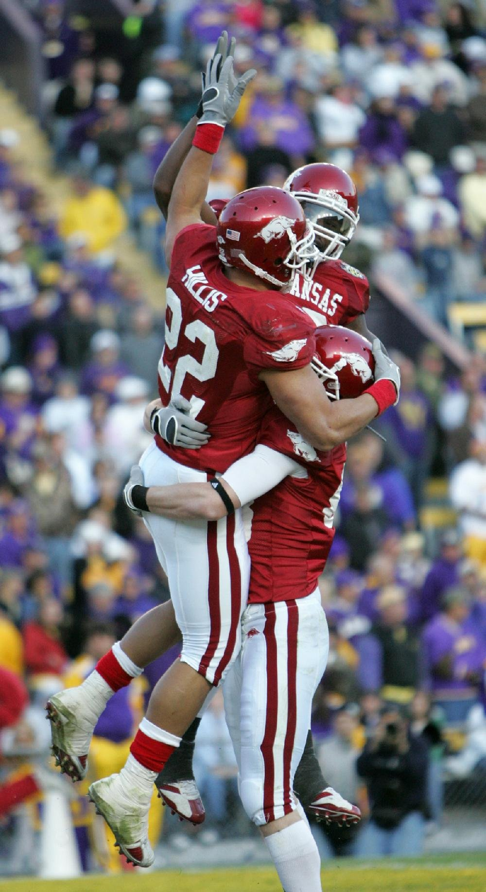 Running back Peyton Hillis (22) celebrates with teammates after scoring a touchdown in the second half. Hillis scored four touchdowns in the game, including two of Arkansas' three scores in the overtime periods.