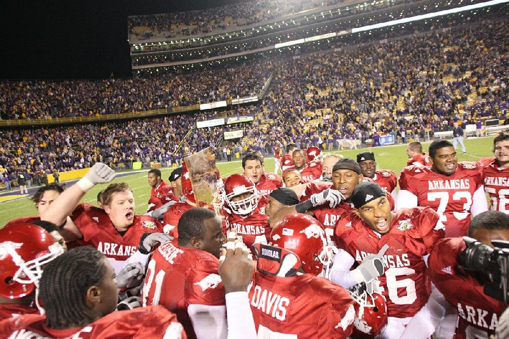 Arkansas players celebrate with the Golden Boot Trophy after defeating LSU in 2007. It was the Razorbacks' first victory over a top-ranked team since beating No. 1 Texas in 1981.