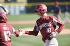 Arkansas outfielder Heston Kjerstad (18) is greeted at home plate by catcher Casey Opitz (12) during a game against South Alabama on Saturday, March 7, 2020, in Fayetteville.