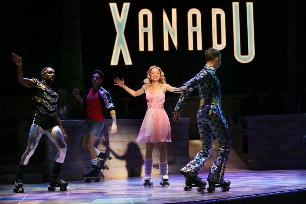 Kerry Butler (center) performs in the Broadway cast of Xanadu, May 22, 2007. (The New York Times)