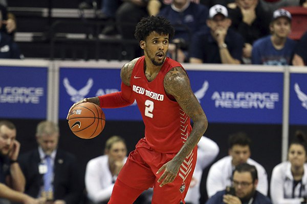 New Mexico's Vance Jackson plays against Utah State during the first half of a Mountain West Conference tournament NCAA college basketball game Thursday, March 5, 2020, in Las Vegas. (AP Photo/Isaac Brekken)