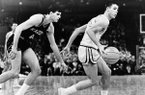 UCLA guard Gail Goodrich skips past Michigan's Jim Meyers and breaks for the basket in the NCAA Championship Game on Saturday, March 22, 1965, in Portland, Ore. Goodrich scored 42 points to lead his team to a 91-80 victory over the nation's top-ranked team. (AP Photo)