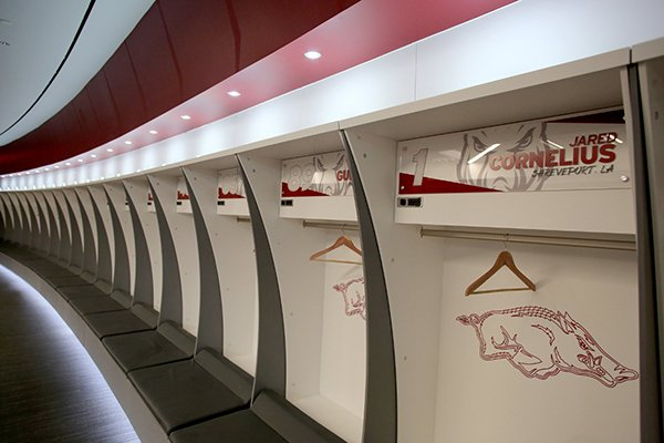 A row of empty lockers are shown on Monday, Aug. 27, 2018, at Donald W. Reynolds Razorback Stadium in Fayetteville. The University of Arkansas is in the process of paying off the $160 million renovation to its football stadium, but like many programs will be negatively affected financially by the coronavirus pandemic that forced the cancellation of spring sports and could interrupt sports, like football, later this year.