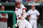 Arkansas outfielder Collin Kuhn bats during a game against Georgia on Friday, April 16, 2010, in Fayetteville.