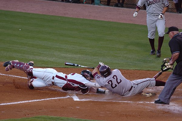 Arkansas catcher James McCann tags Arizona State base runner Jared McDonald (22) at the plate for an out in the second inning of a game Wednesday, April 8, 2009, in Fayetteville.