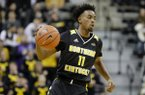 Northern Kentucky's Jalen Tate (11) brings the ball down the court during the first half of an NCAA college basketball game against Missouri Friday, Nov. 8, 2019, in Columbia, Mo. (AP Photo/Jeff Roberson)