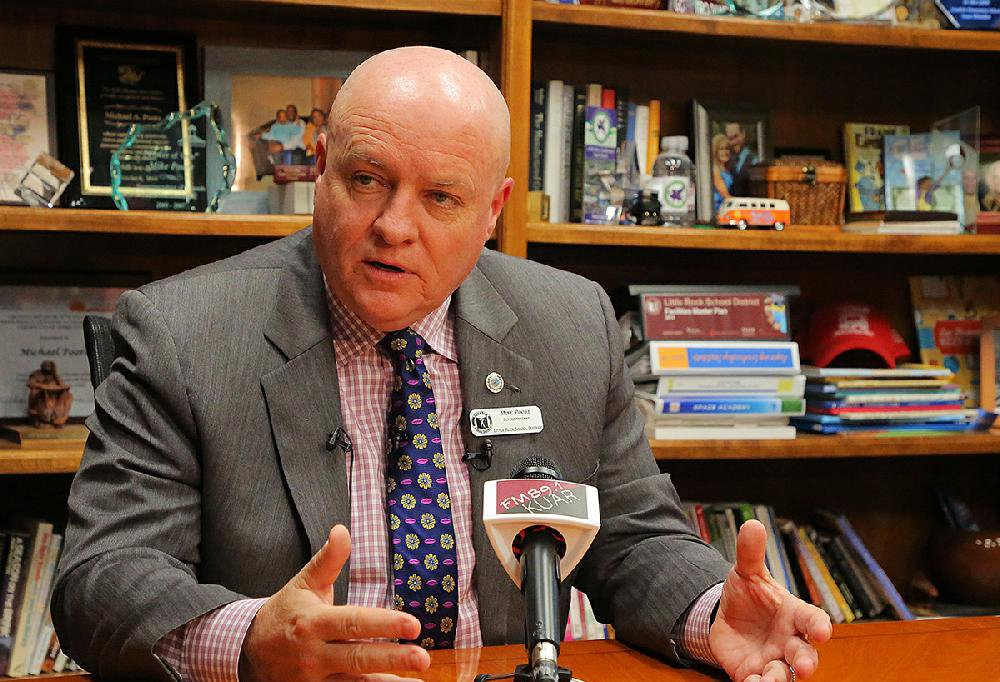 In this file photo Little Rock School District Superintendent Mike Poore talks to reporters at his office in Little Rock.