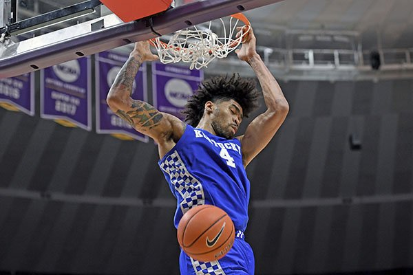 In this Feb. 18, 2020, file photo, Kentucky forward Nick Richards dunks during an NCAA college basketball game against LSU in Baton Rouge, La. Richards was selected to the Associated Press All-SEC first team announced Tuesday, March 10, 2020. (AP Photo/Bill Feig)