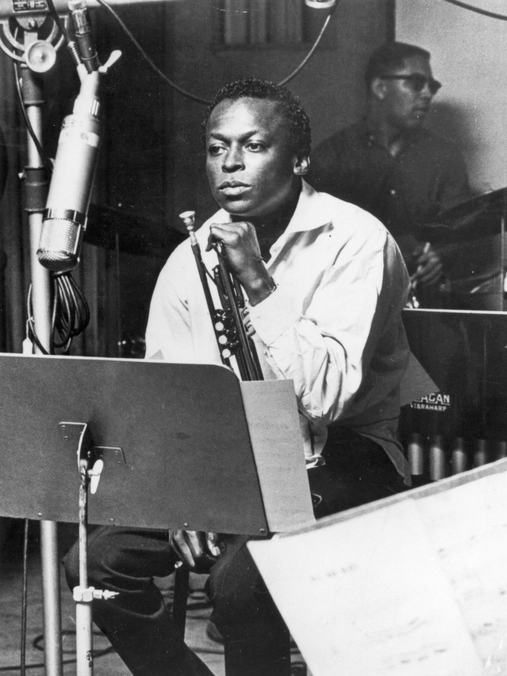 Jazz trumpeter and composer Miles Davis sits with his instrument during a studio recording session in October 1959. (TNS)