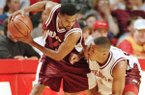 Former Arkansas basketball players Lee Mayberry (left) and Corey Beck are shown during a charity basketball game on Saturday, April 29, 1995, at Bud Walton Arena in Fayetteville. (AP Photo/Tom Ewart)