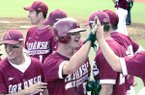 Arkansas' Michael Conner (with helmet) is greeted after scoring during the bottom of the sixth inning of a game against LSU on Sunday, May 6, 2001, in Fayetteville. The Razorbacks won the game to complete a series sweep of the No. 1 Tigers.