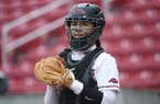 Arkansas catcher Kayla Green looks for the sign from the bench during the Razorbacks game against Furman during an NCAA softball game on Saturday, April 13, 2019 in Fayetteville. (AP Photo/Michael Woods)