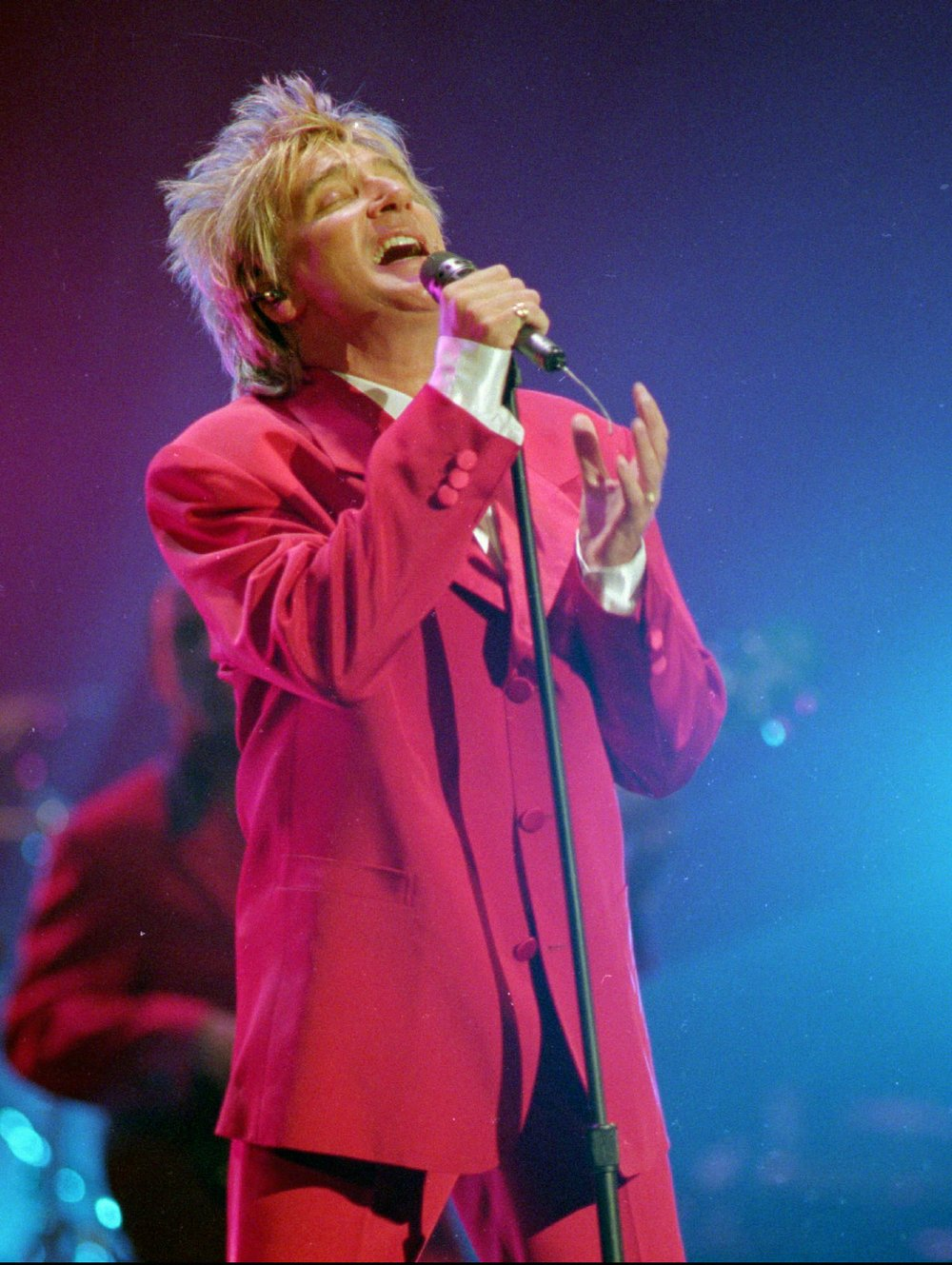 Rod Stewart performs during the 21st American Music Awards at the Shrine Auditorium in Los Angeles in 1994.  (AP file photo/Mark. J. Terrill)