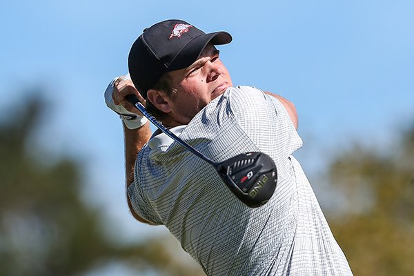 Arkansas golfer Mason Overstreet tees off on the first hole during the first round of an NCAA golf tournament on Monday, Feb. 3, 2020 in Ponte Vedra, Fla. (AP Photo/Gary McCullough)