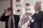 Arkansas baseball coach Dave Van Horn (left) is introduced by athletics director Frank Broyles at a news conference Friday, June 21, 2002, at Bud Walton Arena in Fayetteville.