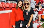 Callie Conway (left) and Maddie Pool are shown prior to a home Arkansas football game.