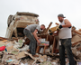 Tornado victims returned to their damaged and destroyed homes Tuesday in Vilonia, sifting through the wreckage for whatever could be salvaged.