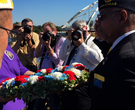 Wreath tossed into Arkansas River before Broadway Bridge closed
