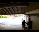 Unknown man walks up to door of house